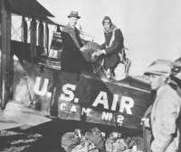 Charles Lindbergh loads the first sack of mail